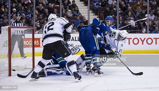 Vancouver Canucks Defenceman Ben Hutton checks Los Angeles Kings Center Anze Kopitar to the ice as Los Angeles Kings Left Wing Marian Gaborik...