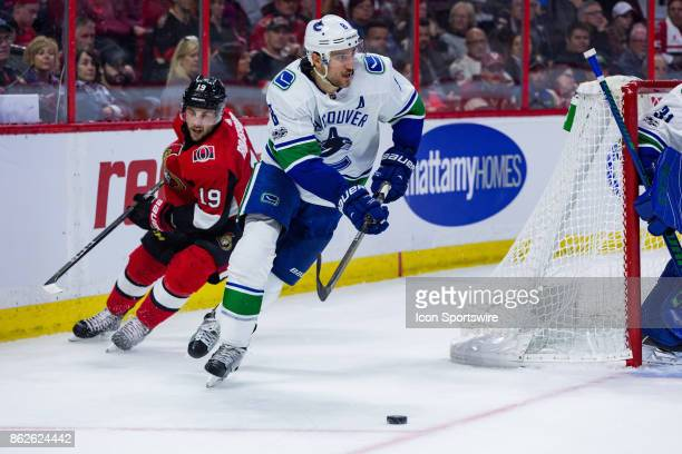 Vancouver Canucks Defenceman Chris Tanev skates the puck out from behind his own net during second period National Hockey League action between the...