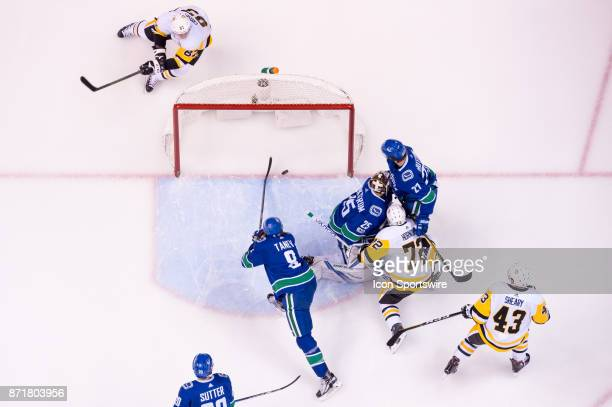 Vancouver Canucks Defenceman Chris Tanev stops the puck from crossing the goal line behind Vancouver Canucks Goalie Jacob Markstrom and Pittsburgh...