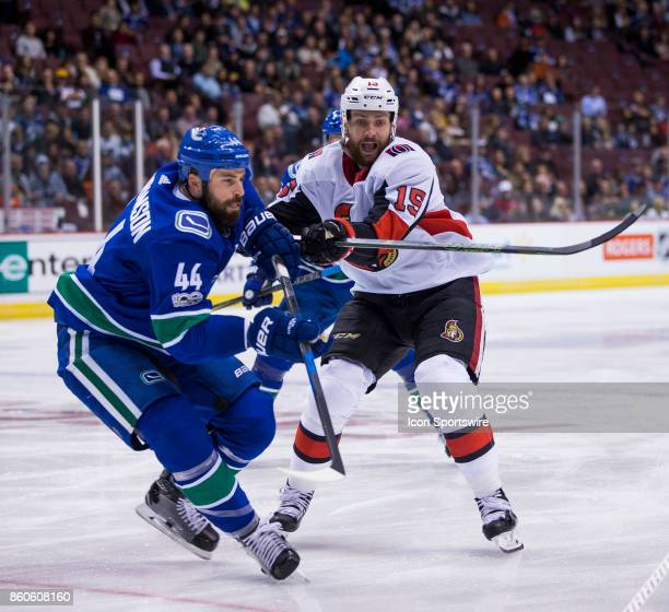 Vancouver Canucks Defenceman Erik Gudbranson attempts to check Ottawa Senators Left Wing Zack Smith during a NHL hockey game on October 10 at Rogers...