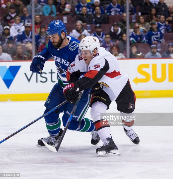 Vancouver Canucks Defenceman Erik Gudbranson checks Ottawa Senators Center Kyle Turris during a NHL hockey game on October 10 at Rogers Arena in...