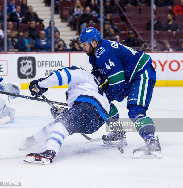 Vancouver Canucks Defenceman Erik Gudbranson checks Winnipeg Jets Center Bryan Little in a NHL hockey game on October 12 at Rogers Arena in Vancouver...