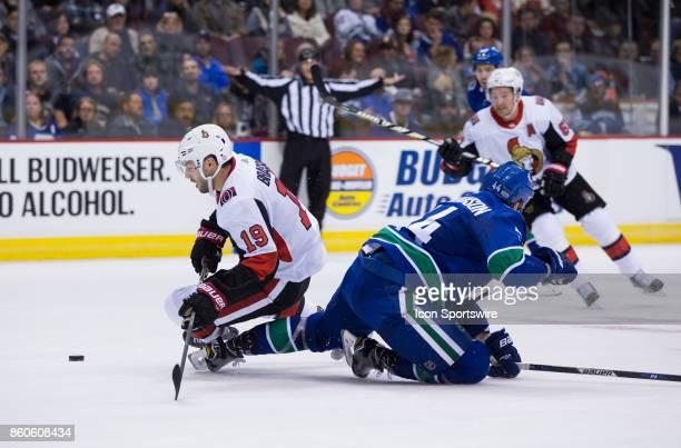 Vancouver Canucks Defenceman Erik Gudbranson collides with Ottawa Senators Center Derick Brassard during a NHL hockey game on October 10 at Rogers...