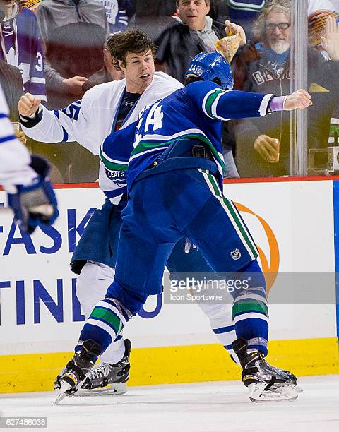 Vancouver Canucks Defenceman Erik Gudbranson fights with Toronto Maple Leafs Left Wing Matt Martin during a NHL hockey game on December 03 at Rogers...