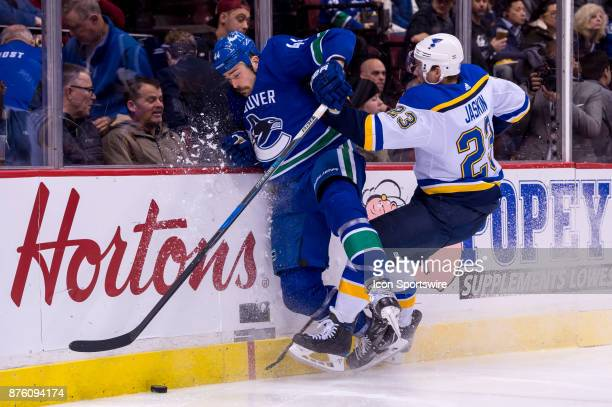 Vancouver Canucks Defenceman Erik Gudbranson is checked by St Louis Blues Right Wing Dmitrij Jaskin during their NHL game at Rogers Arena on November...