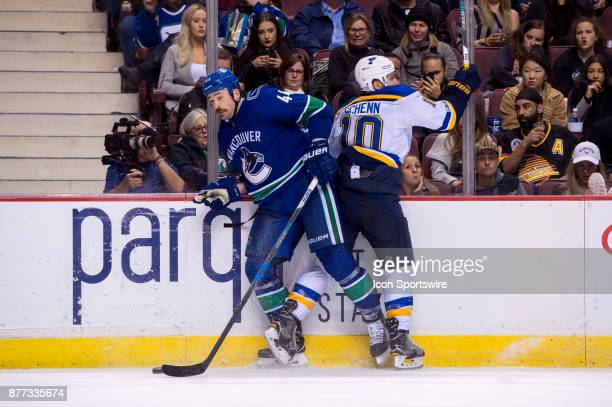 Vancouver Canucks Defenceman Erik Gudbranson is checked by St Louis Blues Center Brayden Schenn during their NHL game at Rogers Arena on November 18...