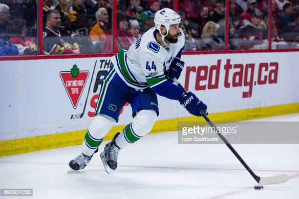 Vancouver Canucks Defenceman Erik Gudbranson skates with the puck around his net during second period National Hockey League action between the...
