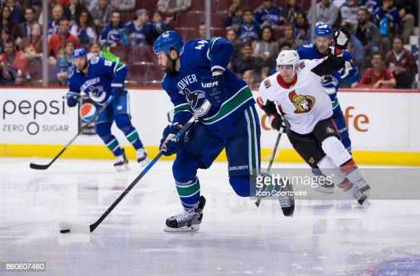 Vancouver Canucks Defenceman Erik Gudbranson stick handles the puck against the Ottawa Senators during a NHL hockey game on October 10 at Rogers...
