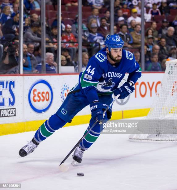 Vancouver Canucks Defenceman Erik Gudbranson stick handles the puck against the Winnipeg Jets in a NHL hockey game on October 12 at Rogers Arena in...