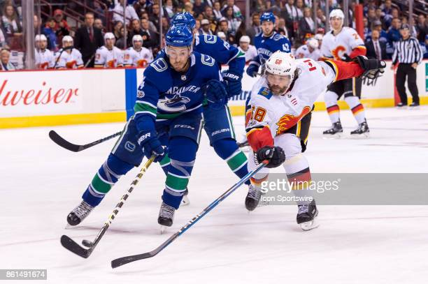 Vancouver Canucks Defenceman Michael Del Zotto and Calgary Flames Right Wing Jaromir Jagr battle for the puck during their NHL game at Rogers Arena...