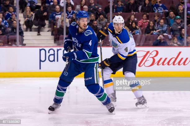 Vancouver Canucks Defenceman Michael Del Zotto skates in front of St Louis Blues Defenceman Carl Gunnarsson during their NHL game at Rogers Arena on...