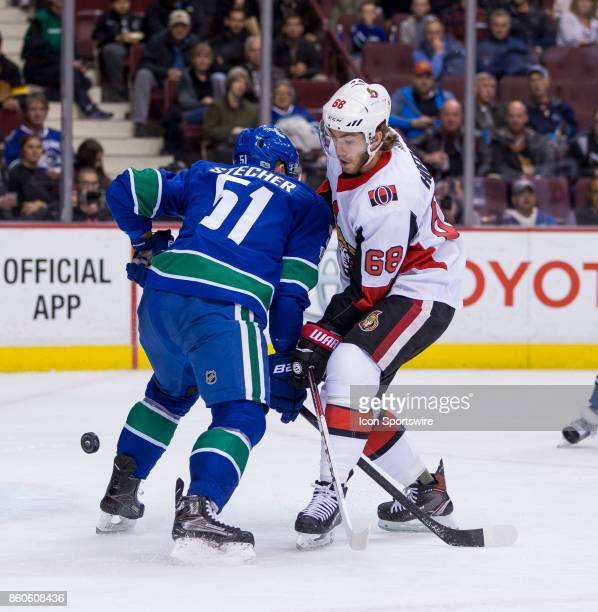Vancouver Canucks Defenceman Troy Stecher checks Ottawa Senators Left Wing Mike Hoffman during a NHL hockey game on October 10 at Rogers Arena in...