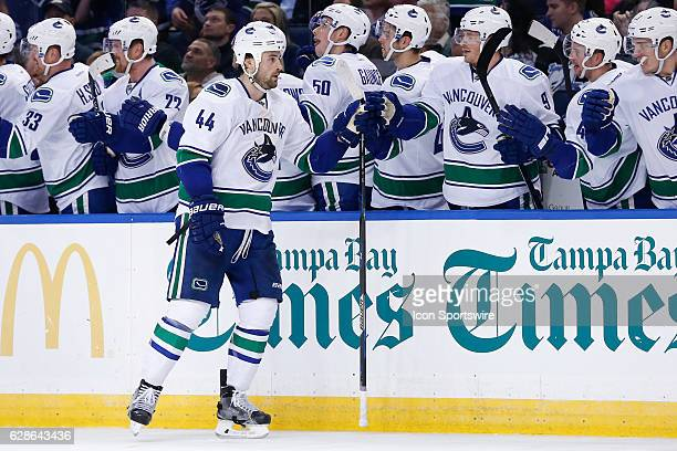 Vancouver Canucks defenseman Erik Gudbranson is congratulated by teammates on the Vancouver Canucks bench after scoring a goal in the first period of...