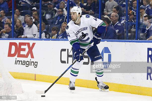 Vancouver Canucks defenseman Erik Gudbranson skates with the puck in the first period of the NHL game between the Vancouver Canucks and the Tampa Bay...
