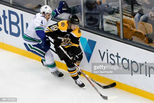 Vancouver Canucks defenseman Michael Del Zotto pressures Boston Bruins left wing Anders Bjork during a game between the Boston Bruins and the...