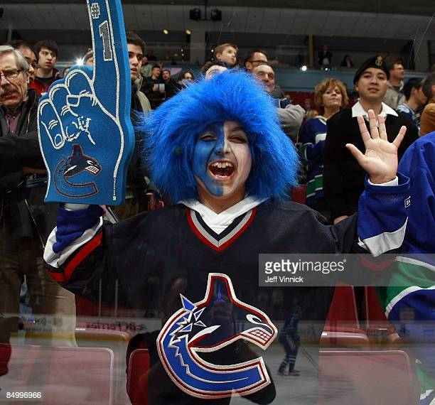 Vancouver Canucks fan cheers during the game between the Vancouver Canucks and the Carolina Hurricanes at General Motors Place on February 3 2009 in...