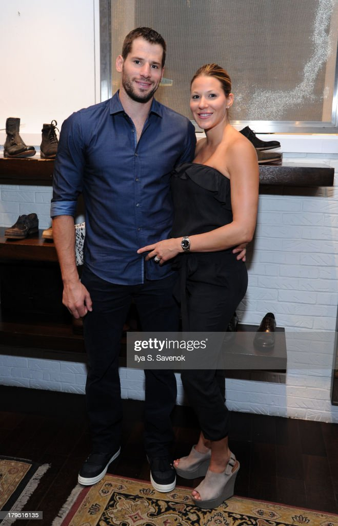 Vancouver Canucks forward <a gi-track='captionPersonalityLinkClicked' href=/galleries/search?phrase=Ryan+Kesler&family=editorial&specificpeople=206915 ng-click='$event.stopPropagation()'>Ryan Kesler</a> (L) and his wife attend John Varvatos event as part of 2013 NHL/NHLPA Player Media Tour on September 4, 2013 in New York City.