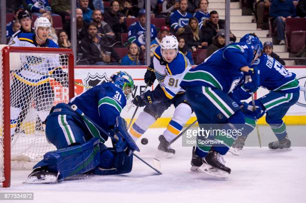 Vancouver Canucks Goalie Anders Nilsson makes a save as St Louis Blues Right Wing Vladimir Tarasenko and Vancouver Canucks Defenceman Derrick Pouliot...