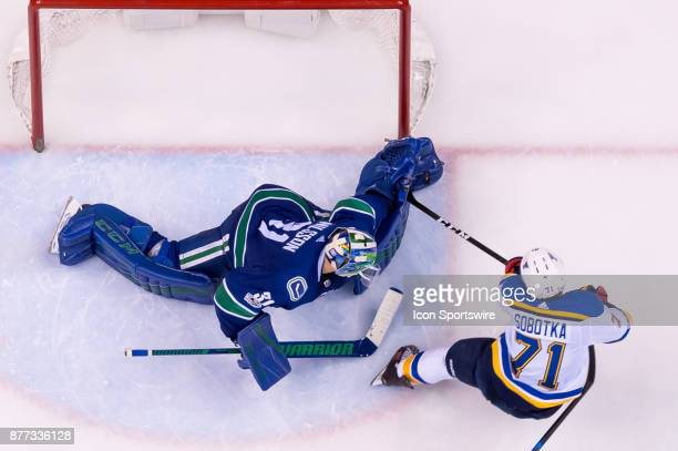 Vancouver Canucks Goalie Anders Nilsson makes a save on St Louis Blues Winger Vladimir Sobotka during their NHL game at Rogers Arena on November 18...