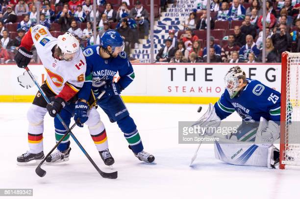 Vancouver Canucks Goalie Jacob Markstrom makes a save while Vancouver Canucks Defenceman Chris Tanev defends against Calgary Flames Right Wing...