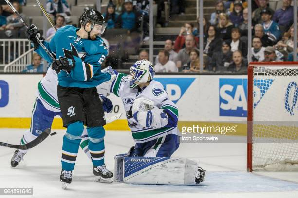 Vancouver Canucks goalie Richard Bachman makes a save as San Jose Sharks right wing Marcus Sorensen looks for the rebound during the third period of...