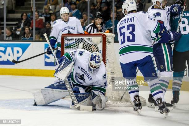 Vancouver Canucks goalie Richard Bachman makes a save during the first period of the regular season game between the Vancouver Canucks and the San...
