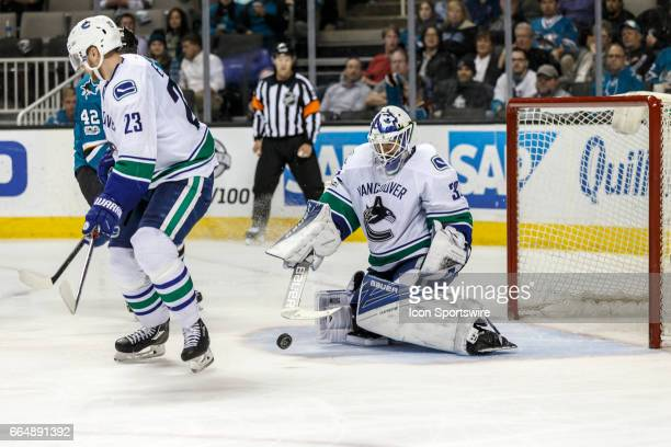 Vancouver Canucks goalie Richard Bachman makes a stick save during the third period of the regular season game between the Vancouver Canucks and the...