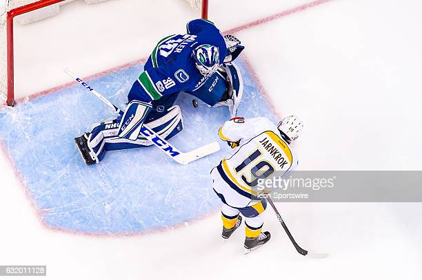 Vancouver Canucks Goalie Ryan Miller makes a save on Nashville Predators Center Calle Jarnkrok during their NHL game at Rogers Arena on January 17...