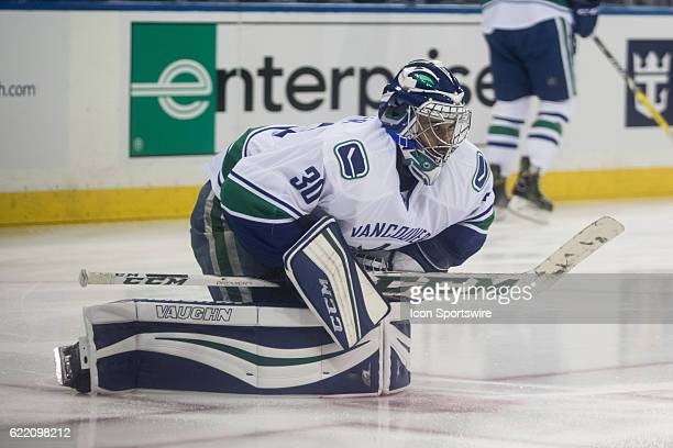 Vancouver Canucks Goalie Ryan Miller stretches during player warmups prior to the start of a regular season NHL game between the Vancouver Canucks...