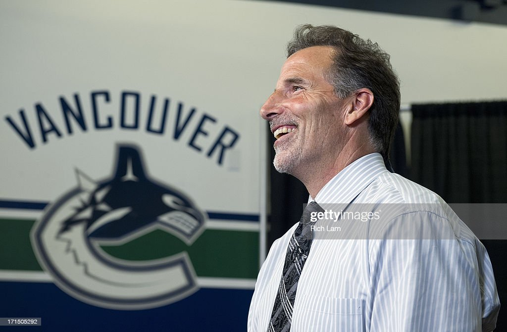 Vancouver Canucks head coach <a gi-track='captionPersonalityLinkClicked' href=/galleries/search?phrase=John+Tortorella&family=editorial&specificpeople=213393 ng-click='$event.stopPropagation()'>John Tortorella</a> laughs while taking part in an interview after a press conference announcing him as the new head coach of the team, June 25, 2013 at Rogers Arena in Vancouver, British Columbia, Canada.