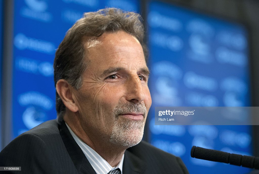 Vancouver Canucks head coach <a gi-track='captionPersonalityLinkClicked' href=/galleries/search?phrase=John+Tortorella&family=editorial&specificpeople=213393 ng-click='$event.stopPropagation()'>John Tortorella</a> listens to a question during a press conference announcing him as the new head coach of the team, June 25, 2013 at Rogers Arena in Vancouver, British Columbia, Canada.