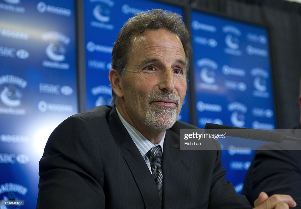 Vancouver Canucks head coach <a gi-track='captionPersonalityLinkClicked' href=/galleries/search?phrase=John+Tortorella&family=editorial&specificpeople=213393 ng-click='$event.stopPropagation()'>John Tortorella</a> listens to a questiong during a press conference announcing him as the new head coach of the team, June 25, 2013 at Rogers Arena in Vancouver, British Columbia, Canada.