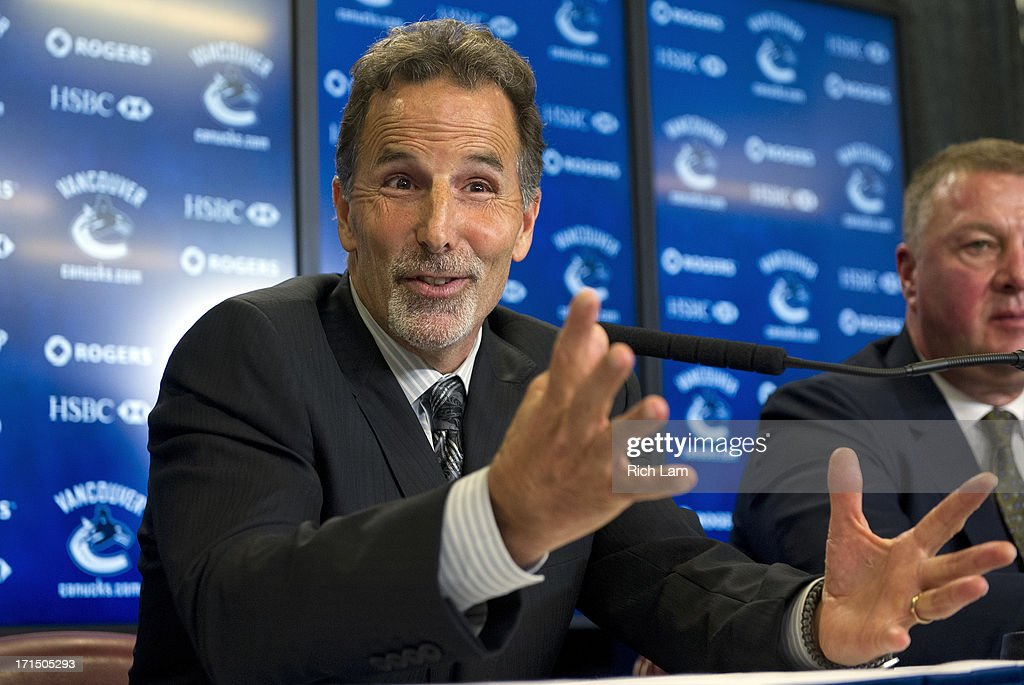 Vancouver Canucks head coach John Tortorella smiles while answering a question during a press conference June 25, 2013 at Rogers Arena in Vancouver, British Columbia, Canada.