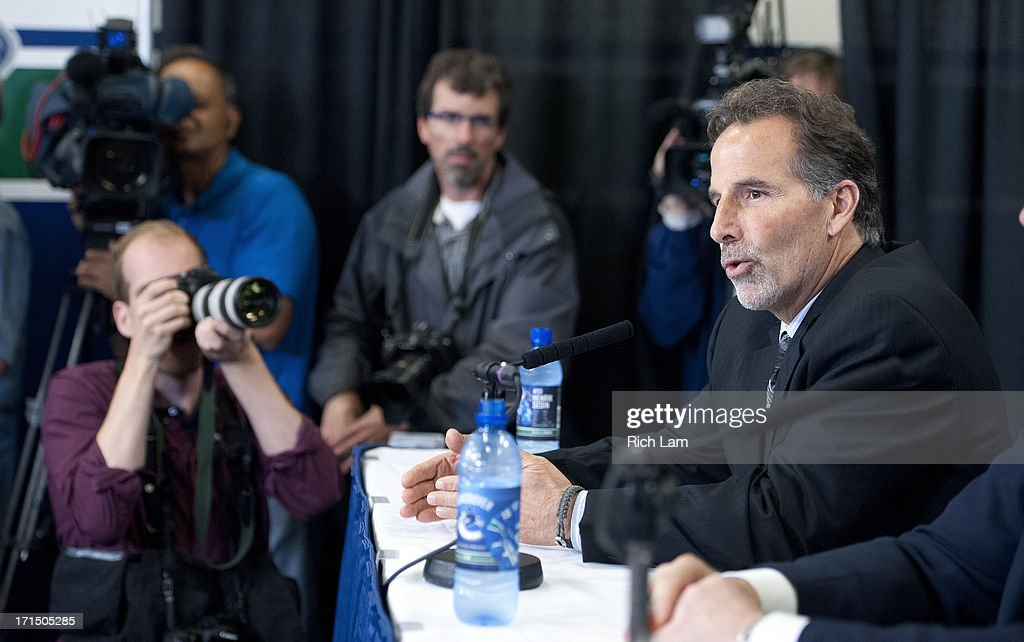 Vancouver Canucks head coach <a gi-track='captionPersonalityLinkClicked' href=/galleries/search?phrase=John+Tortorella&family=editorial&specificpeople=213393 ng-click='$event.stopPropagation()'>John Tortorella</a> speaks to a large crowd of journalists during a press conference June 25, 2013 at Rogers Arena in Vancouver, British Columbia, Canada.