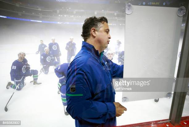 Vancouver Canucks head coach Travis Green explains a drill during their practice at MercedesBenz Arena September 19 2017 in Shanghai China The...