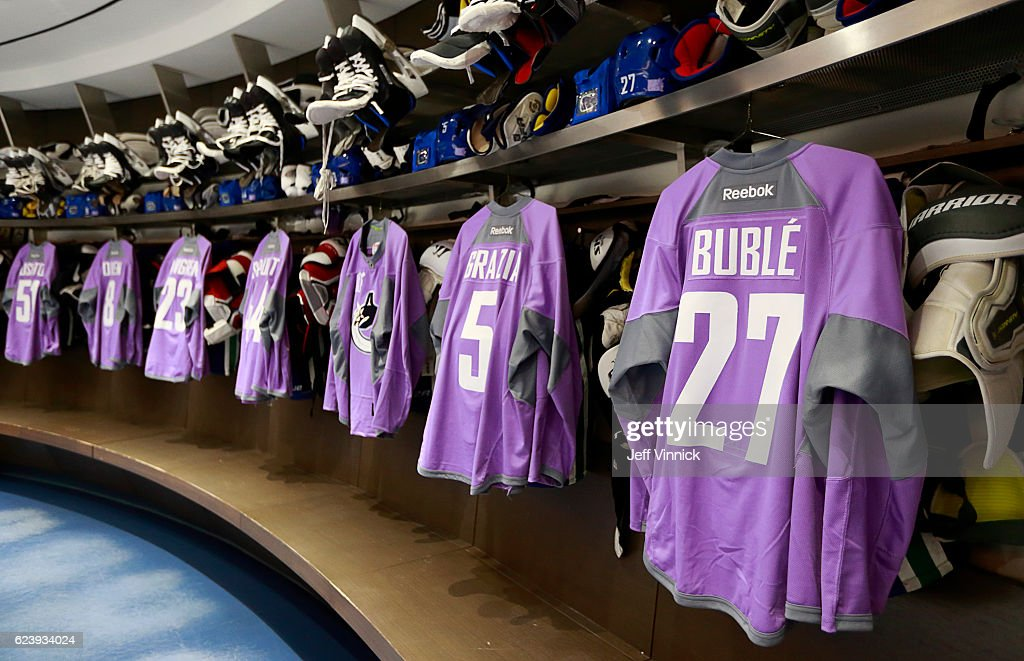 A Vancouver Canucks Hockey Fights Cancer jersey with the name of singer Michael Buble's son Noah Buble hangs in the dressing room before their NHL game against the Arizona Coyotes at Rogers Arena November 17, 2016 in Vancouver, British Columbia, Canada. Noah Buble was recently diagnosed with liver cancer.
