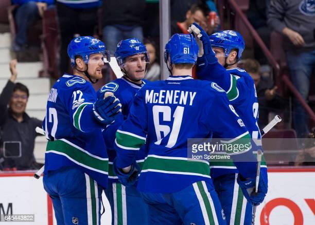 Vancouver Canucks Left Wing Daniel Sedin and Left Wing Alexandre Burrows and Center Henrik Sedin and Defenceman Evan McEneny celebrate Daniel Sedin's...