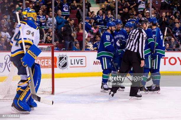 Vancouver Canucks Left Wing Sven Baertschi is congratulated after scoring a goal on St Louis Blues Goalie Jake Allen during their NHL game at Rogers...