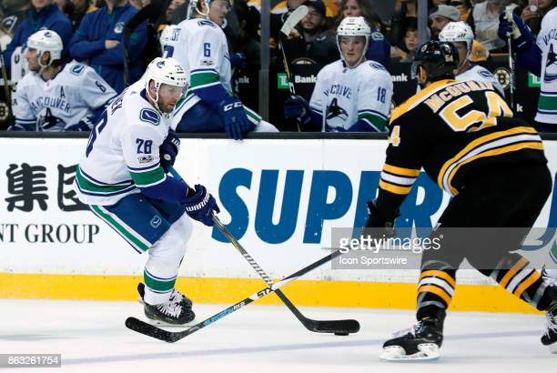 Vancouver Canucks left wing Thomas Vanek gains the blue line watched by Boston Bruins right defenseman Adam McQuaid during a game between the Boston...