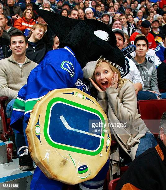 Vancouver Canucks mascot Fin takes a bite of actress Anne Heche at General Motors Place on November 24 2008 in Vancouver British Columbia Canada