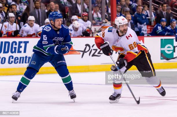 Vancouver Canucks Right Wing Derek Dorsett defends against Calgary Flames Right Wing Jaromir Jagr during their NHL game at Rogers Arena on October 14...