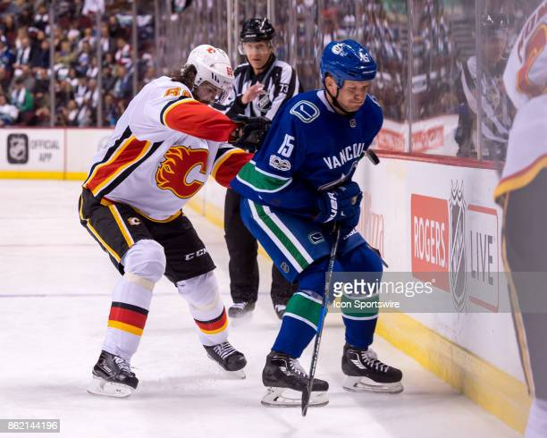 Vancouver Canucks Right Wing Derek Dorsett is checked by Calgary Flames Right Wing Jaromir Jagr during their NHL game at Rogers Arena on October 14...