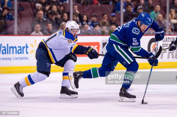 Vancouver Canucks Right Wing Derek Dorsett is checked by St Louis Blues Right Wing Vladimir Tarasenko during their NHL game at Rogers Arena on...