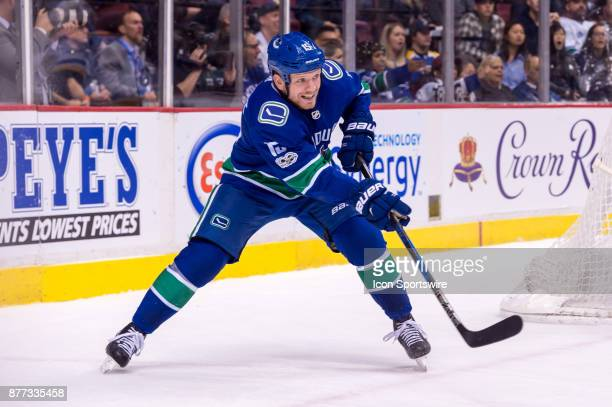 Vancouver Canucks Right Wing Derek Dorsett plays the puck during their NHL game against the St Louis Blues at Rogers Arena on November 18 2017 in...