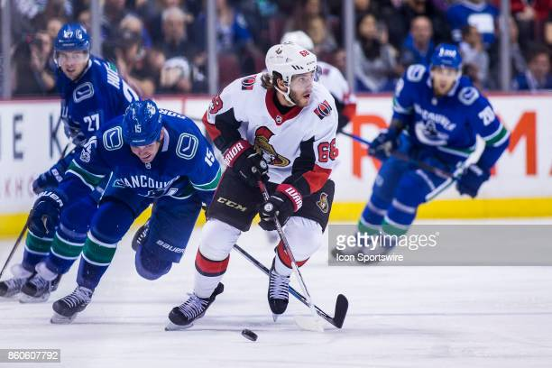 Vancouver Canucks Right Wing Derek Dorsett skates after Ottawa Senators Left Wing Mike Hoffman during a NHL hockey game on October 10 at Rogers Arena...