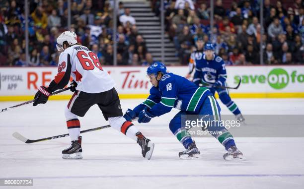 Vancouver Canucks Right Wing Jake Virtanen attempts to check Ottawa Senators Left Wing Mike Hoffman during a NHL hockey game on October 10 at Rogers...