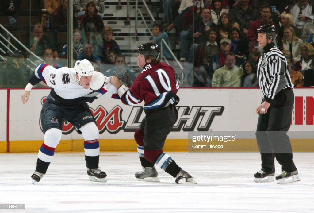 Vancouver Canucks right wing Lee Goren (L) and Colorado Avalanche left wing <a gi-track='captionPersonalityLinkClicked' href=/galleries/search?phrase=Brad+May&family=editorial&specificpeople=212874 ng-click='$event.stopPropagation()'>Brad May</a> fight during the game between the Vancouver Canucks and the Colorado Avalanche at Pepsi Center in Denver, Colorado, on October 29, 2005.