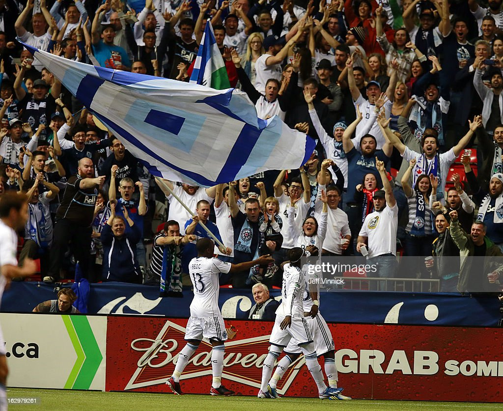 Vancouver fans celebrate the only goal scored by the Vancouver Whitecaps FC against the Toronto FC during their MLS game March 2, 2013 at B.C. Place in Vancouver, British Columbia, Canada. Vancouver won 1-0.