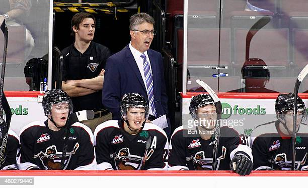 Vancouver Giants head coach Claude Noel watches his team take on the Prince Albert Raiders during the third period of their WHL game at the Pacific...
