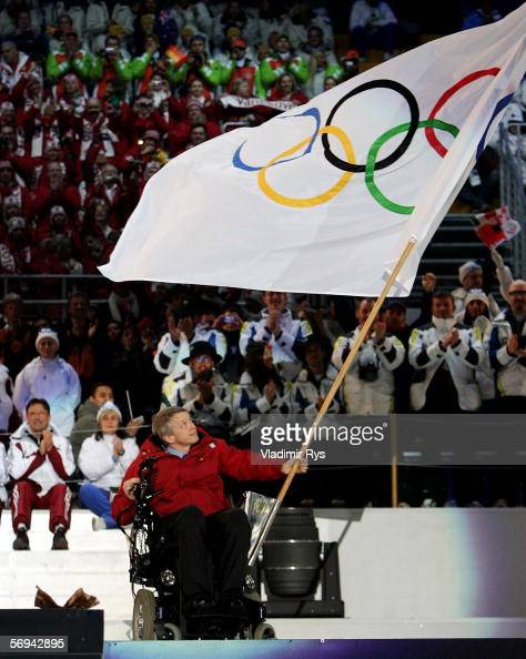 Vancouver Mayor Sam Sullivan holds the Olympic Flag during the Closing Ceremony of the Turin 2006 Winter Olympic Games on February 26 2006 at the...
